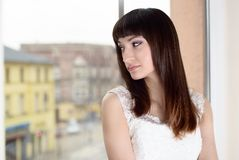 Beautiful bride looking out the window Royalty Free Stock Image