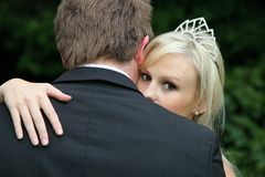 Beautiful Bride Looking Over Husband's Shoulder Stock Photo