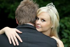 Beautiful Bride Looking Over Husband's Shoulder Royalty Free Stock Photography