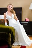 Beautiful bride in the luxurious bedroom Royalty Free Stock Photo
