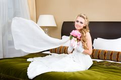 Beautiful bride in the luxurious bedroom Stock Images