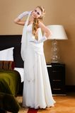Beautiful bride in the luxurious bedroom Stock Photography