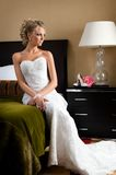 Beautiful bride in the luxurious bedroom Stock Image