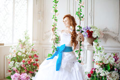 Beautiful bride in a luxurious interior with flowers Stock Images
