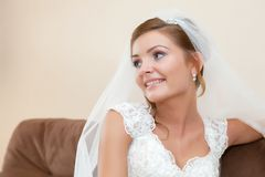 Beautiful bride in a luxurious wedding dress Royalty Free Stock Images