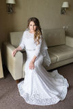Beautiful bride in luxury hotel room. Stock Photography