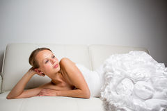 Beautiful bride lying on a sofa Royalty Free Stock Images