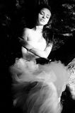 Beautiful bride lying on tree with closed eyes Stock Photography