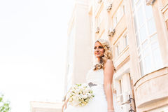 Beautiful bride in magnificent dress stands alone stock photos