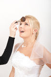 Beautiful bride and make-up artist Stock Image