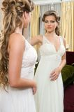 Beautiful bride at the mirror Stock Images