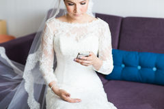 Beautiful bride  with mobile phone. Concept of love and interest. Newlywed Royalty Free Stock Photos