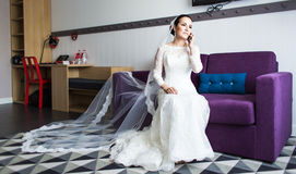 Beautiful bride  with mobile phone. Concept of love and  interest. Newlywed Royalty Free Stock Photo