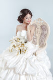 Beautiful bride model girl wearing in wedding dress with volumin Stock Photos