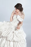 Beautiful bride model woman wearing in wedding dress with volumi Stock Photography