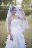 Beautiful bride in a natural outdoor setting Stock Photo