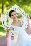 Beautiful bride in natural park stock images