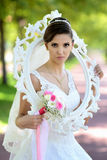 Beautiful bride in natural park stock image