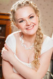 Beautiful bride near fireplace Stock Image