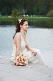 Beautiful bride near lake Royalty Free Stock Photography