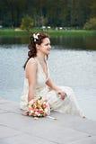 Beautiful bride near lake Royalty Free Stock Photography
