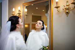 Beautiful bride near mirror Royalty Free Stock Photos