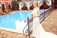 Beautiful bride near pool royalty free stock images