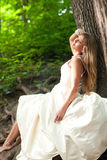 Beautiful bride near the tree Stock Photo