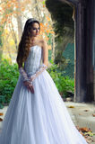 Beautiful bride in the old building on autumn day Stock Images