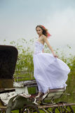 Beautiful bride and old  carriage Stock Photography