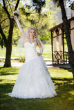 Beautiful Bride On A Green Grass Royalty Free Stock Image