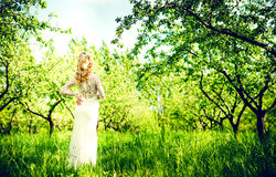 Beautiful bride outdoor in the park, back view Stock Image