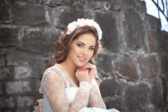 Beautiful bride outdoors. Castle. Wedding day. Royalty Free Stock Image