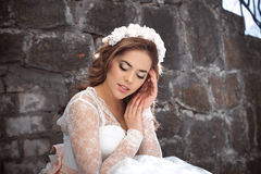 Beautiful bride outdoors. Castle. Wedding day. Stock Photography