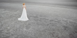 Beautiful bride outdoors in a desert. Stock Photography