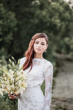 Beautiful bride outdoors Royalty Free Stock Photos
