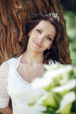 Beautiful bride outdoors in a forest. Crimea. Royalty Free Stock Image