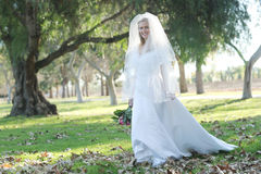 Beautiful Bride Outdoors in a Forest Royalty Free Stock Photo