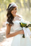 Beautiful bride outdoors in a forest Stock Photo
