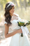 Beautiful bride outdoors in a forest Stock Images