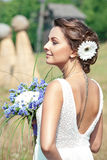 Beautiful bride outdoors. Bride at outdoor in a morning surrounding by golden sunlight Stock Images