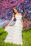 Beautiful bride outdoors in a park Stock Photography