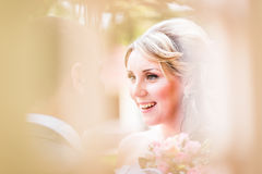 Beautiful bride outdoors in a park royalty free stock image