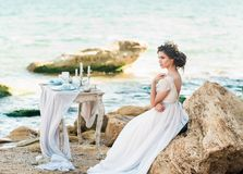 Beautiful bride outdoors. Wedding hairstyle and make up. royalty free stock photos