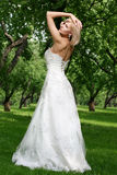 Beautiful bride in the park. Alone Royalty Free Stock Photos
