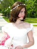 Beautiful bride at the park. Waiting groom Royalty Free Stock Photos
