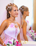 Beautiful bride in a pink dress near the mirror Stock Photography
