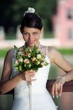 Beautiful Bride Portrait. A half body portrait of a beautiful bride holding a bouquet of flowers in her hand Royalty Free Stock Photo