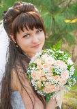 Beautiful bride. Portrait beautiful bride outdoors in a forest Stock Images