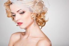 Beautiful bride portrait wearing professional make-up Stock Photos